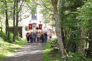 Procession from the Kreuzberg monastery up to the crosses on the mountain.   Picture courtesy of Wikpedia.